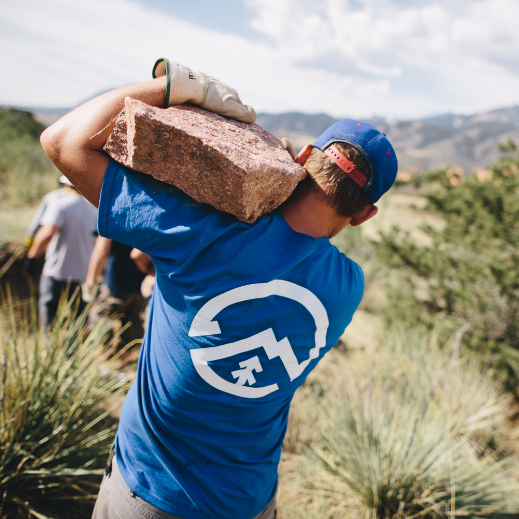 Volunteer moving slab of granite